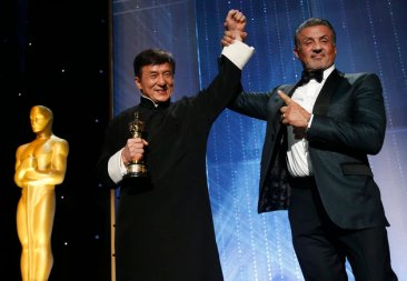 Actor Jackie Chan is congratulated by fellow actor Sylvester Stallone (R) after accepting his Honorary Award at the 8th Annual Governors Awards in Los Angeles, California, U.S., November 12, 2016. REUTERS/Mario Anzuoni