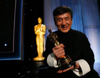 Actor Jackie Chan poses with his Honorary Award at the 8th Annual Governors Awards in Los Angeles, California, U.S., November 12, 2016. REUTERS/Mario Anzuoni